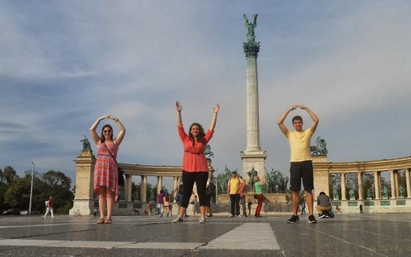 Graduate students in an East European country doing the O-H-I-O symbol